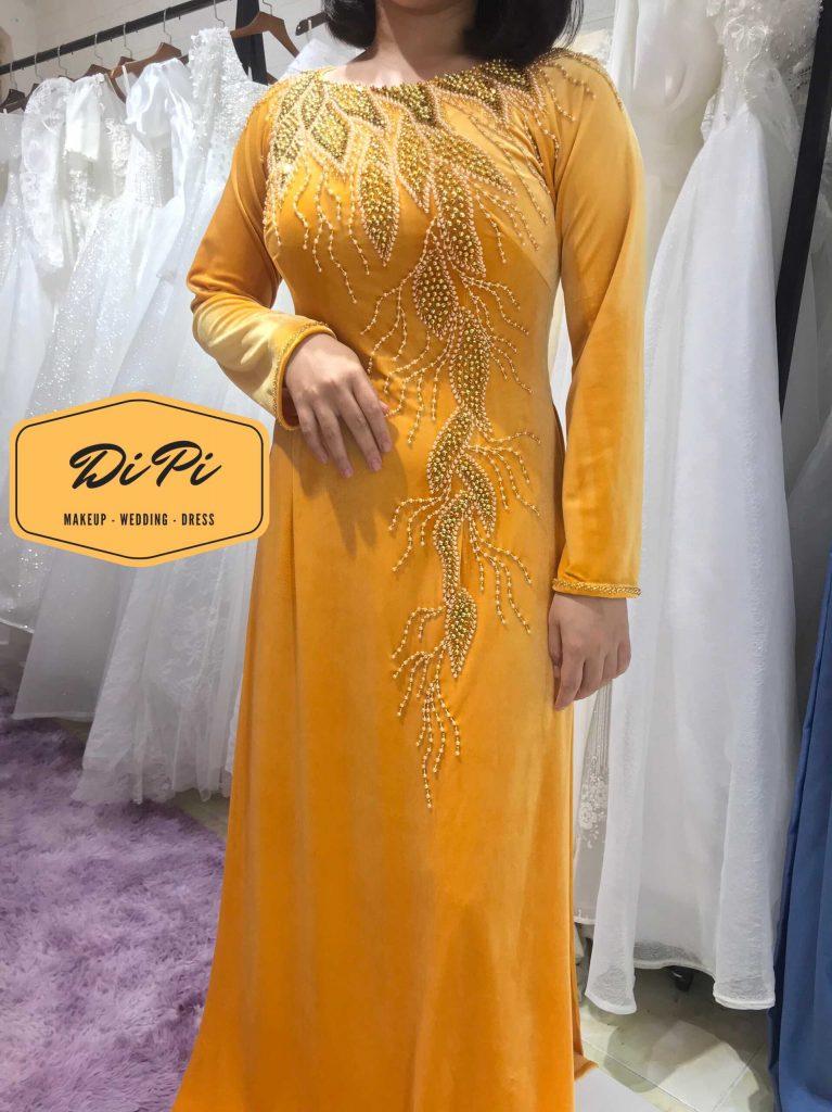 áo dài sui gia màu vàng